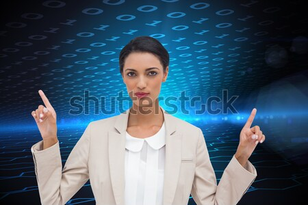 Businesswoman pressing button on touch screen against a backgrou Stock photo © wavebreak_media