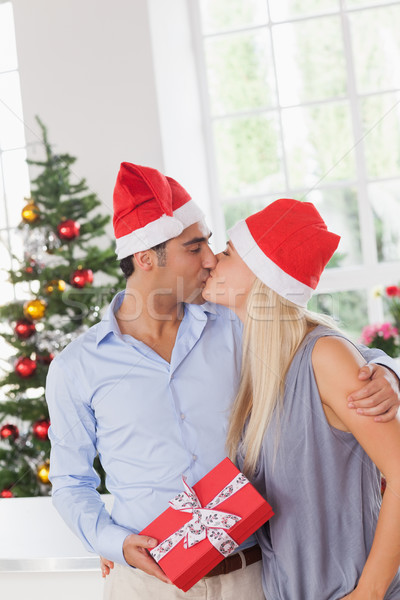 Kissing couple at christmas Stock photo © wavebreak_media