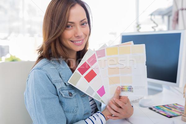 Smiling interior designer holding up colour samples Stock photo © wavebreak_media
