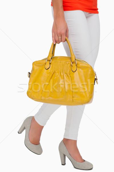женщину ходьбе желтый сумку белый Сток-фото © wavebreak_media