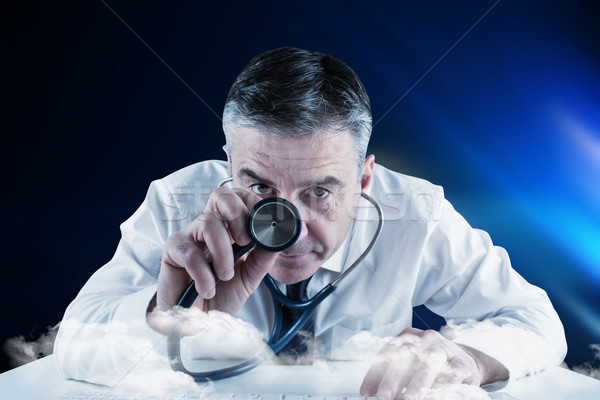 Composite image of mature businessman running diagnostics Stock photo © wavebreak_media