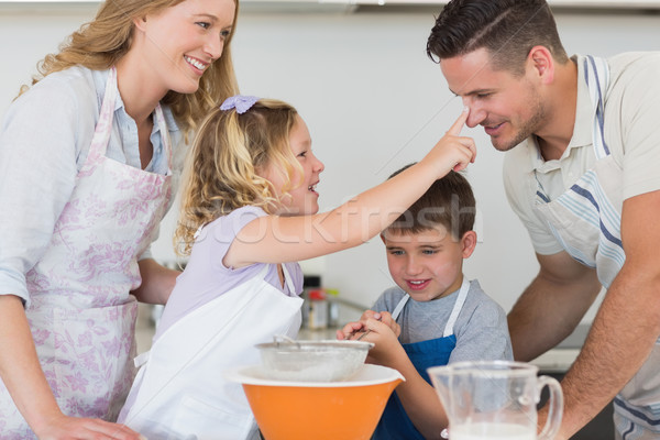 Parents and children baking cookies Stock photo © wavebreak_media