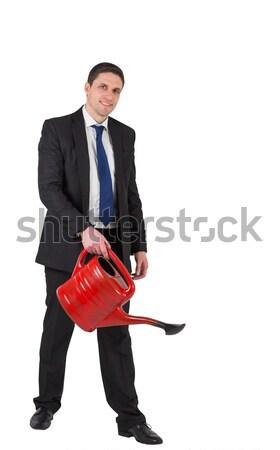 üzletember locsol piros konzerv mosolyog kamera Stock fotó © wavebreak_media