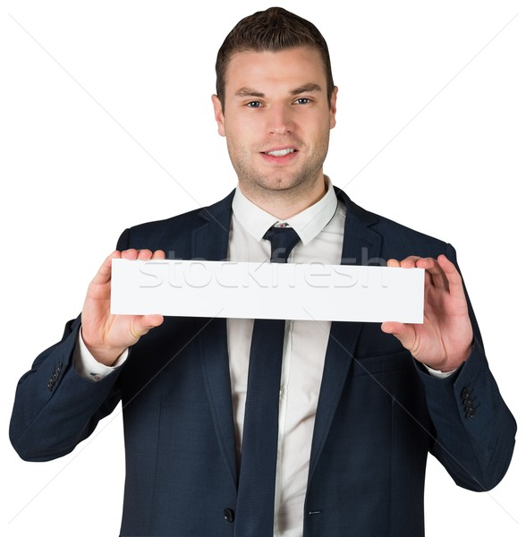 Happy businessman showing card to camera Stock photo © wavebreak_media