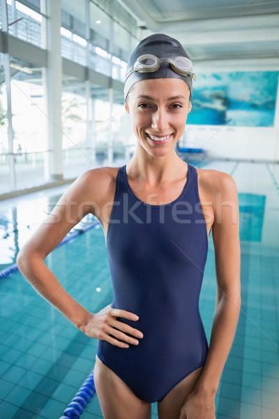 Stockfoto: Mooie · zwemmer · permanente · zwembad · glimlachend · camera