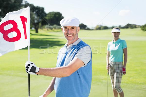 счастливым гольфист дыра флаг партнера Сток-фото © wavebreak_media