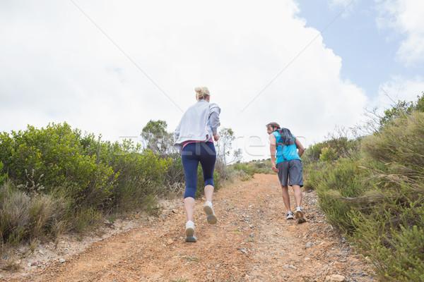 Fit attractive couple jogging up mountain trail Stock photo © wavebreak_media