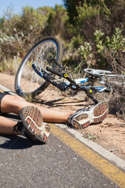 Cyclist lying on the road after an accident Stock photo © wavebreak_media