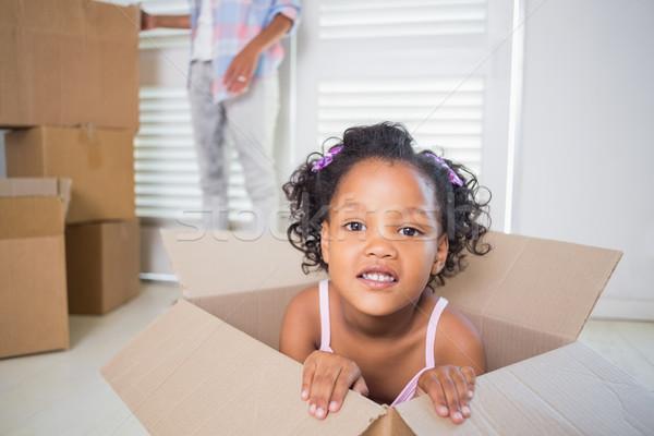 Cute daughter sitting in moving box  Stock photo © wavebreak_media