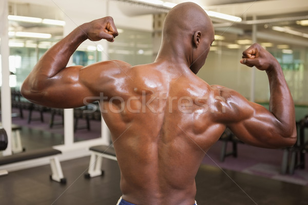 Rear view of shirtless muscular man flexing muscles Stock photo © wavebreak_media