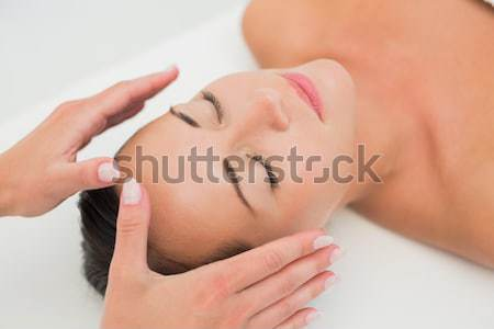 Hand cleaning womans face with cotton swab Stock photo © wavebreak_media