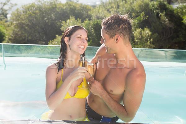 çift şampanya flüt yüzme havuzu gülen romantik Stok fotoğraf © wavebreak_media