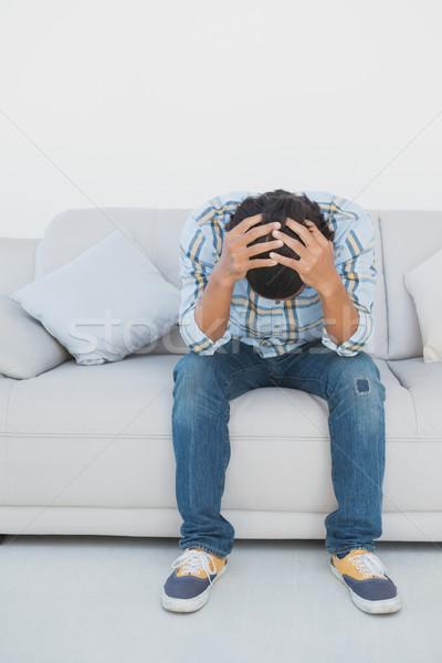 Tensed football fan sitting on couch Stock photo © wavebreak_media