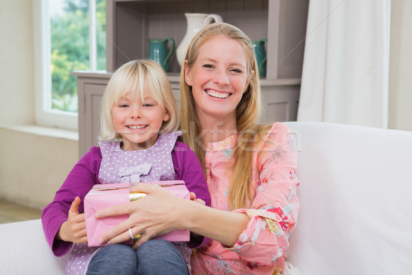 Little girl surprising her mother with gift  Stock photo © wavebreak_media