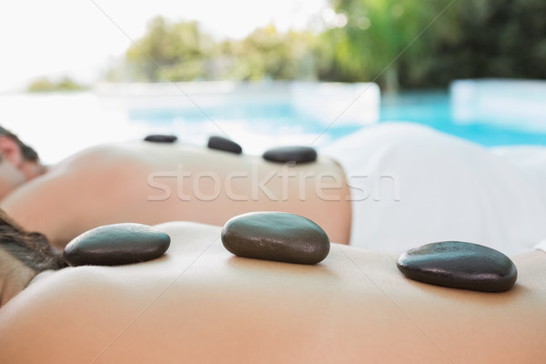 Mid section of a couple enjoying stone massage Stock photo © wavebreak_media