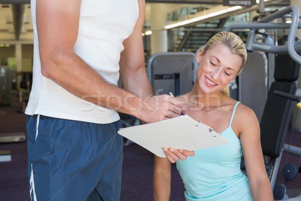女性 パフォーマンス クリップボード トレーナー 美しい ストックフォト © wavebreak_media