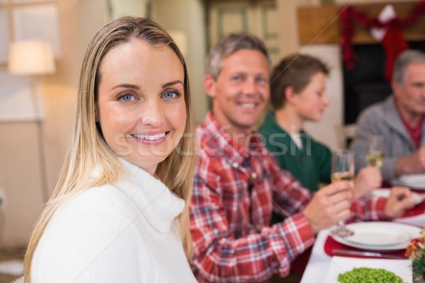 Woman smiling at camera during christmas dinner Stock photo © wavebreak_media