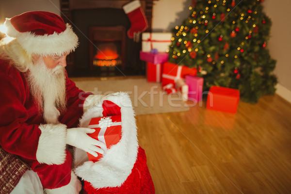 サンタクロース ストッキング 贈り物 クリスマス ホーム リビングルーム ストックフォト © wavebreak_media