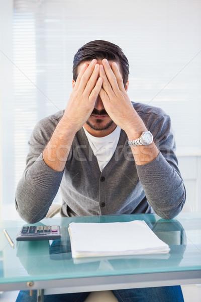 Worried businessman with head in hands Stock photo © wavebreak_media