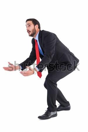 Görbület üzletember tart kéz ki felfelé néz Stock fotó © wavebreak_media