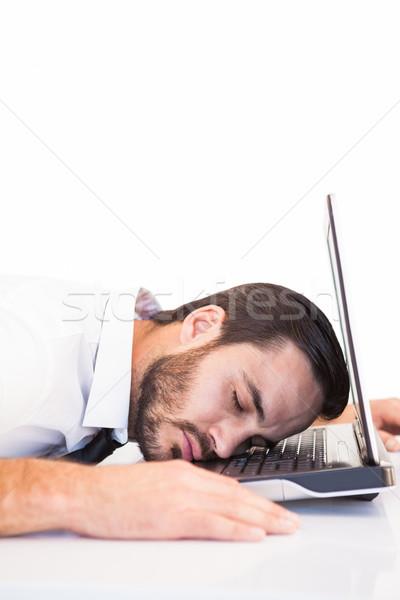 Businessman resting head on laptop keyboard Stock photo © wavebreak_media