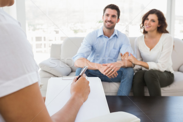Reconciled couple smiling and talking with their therapist  Stock photo © wavebreak_media