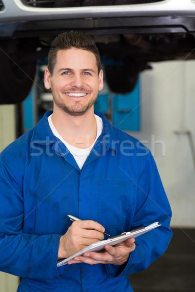 механиком улыбаясь камеры ремонта гаража Дать Сток-фото © wavebreak_media