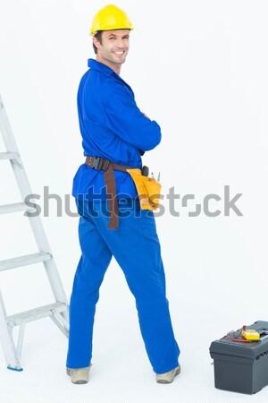 Feliz eletricista olhando ombro retrato branco Foto stock © wavebreak_media