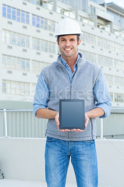 Happy male architect showing digital tablet outdoors Stock photo © wavebreak_media