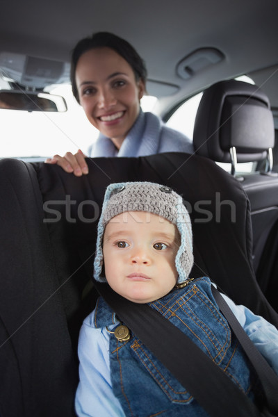 Mother checking her baby in the car seat Stock photo © wavebreak_media