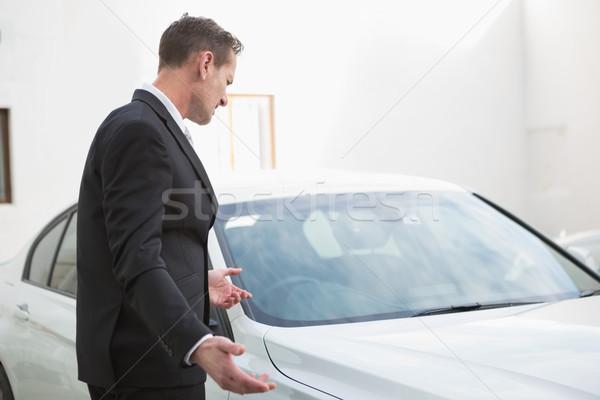 Businessman looking his car engine after breaking down Stock photo © wavebreak_media