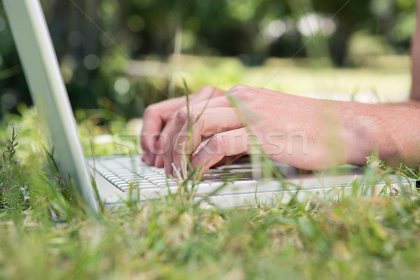 Man using laptop in the park Stock photo © wavebreak_media