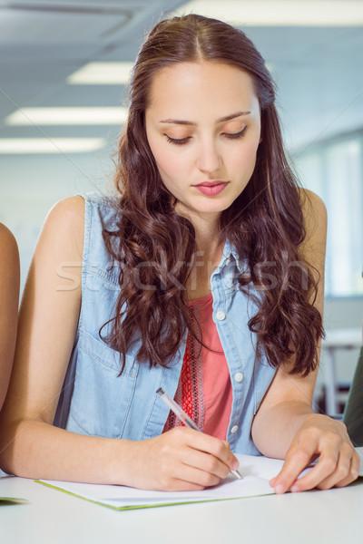 Student taking notes in class Stock photo © wavebreak_media
