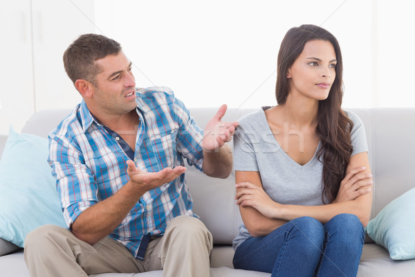 Man arguing with angry woman on sofa Stock photo © wavebreak_media
