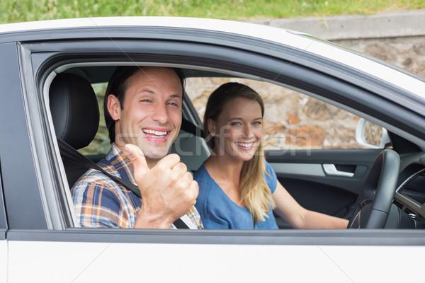 Casal sorridente câmera carro mulher mãos Foto stock © wavebreak_media