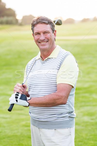 Golfista piedi club sorridere fotocamera Foto d'archivio © wavebreak_media