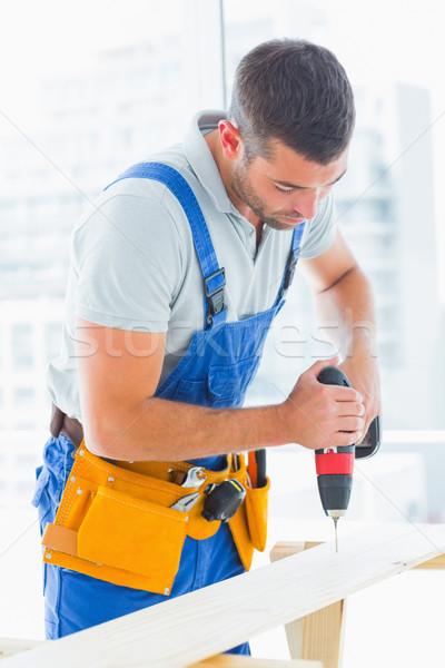ács fúrás lyuk palánk iroda férfi Stock fotó © wavebreak_media