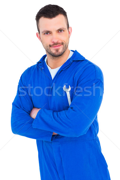 Happy mechanic holding spanner on white background Stock photo © wavebreak_media