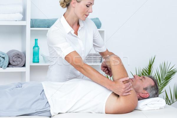 Médico paciente braço médico escritório Foto stock © wavebreak_media