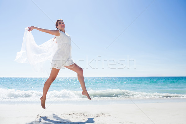 Peaceful brunette jumping Stock photo © wavebreak_media