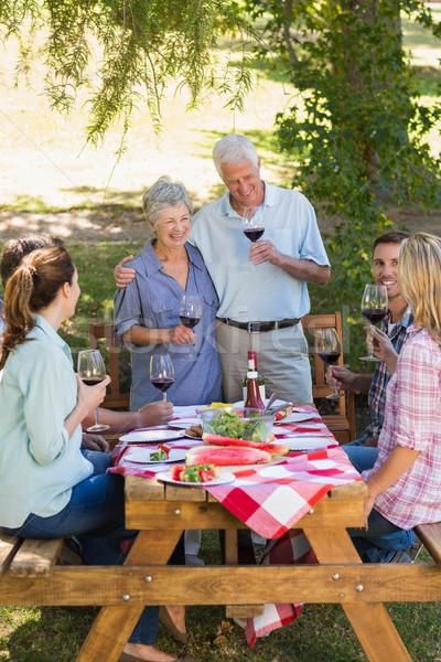 Happy seniors toasting with their family Stock photo © wavebreak_media