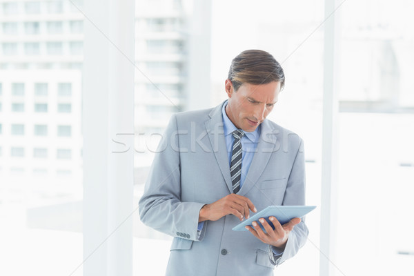 Concentrate businessman using tablet pc  Stock photo © wavebreak_media