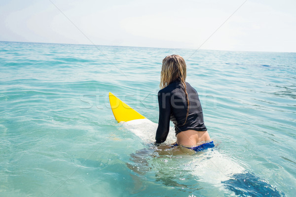 woman with a surfboard on a sunny day Stock photo © wavebreak_media