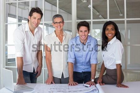 Sorridere imprenditore posa braccia piegato ufficio Foto d'archivio © wavebreak_media