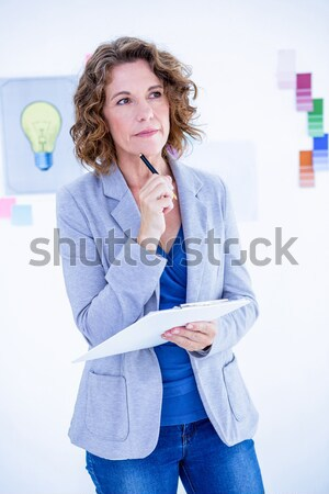 Brown haired woman calling with her mobile phone Stock photo © wavebreak_media