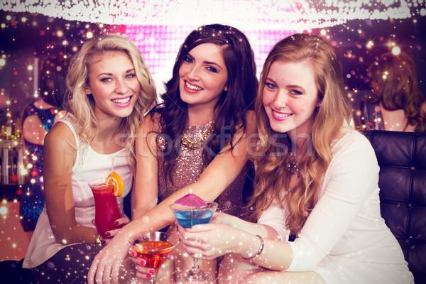 Composite image of friends drinking cocktails  Stock photo © wavebreak_media