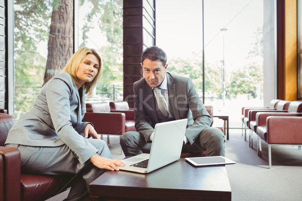 Focused business team having a meeting using laptop Stock photo © wavebreak_media