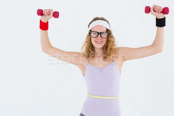 Geeky hipster lifting dumbbells in sportswear Stock photo © wavebreak_media