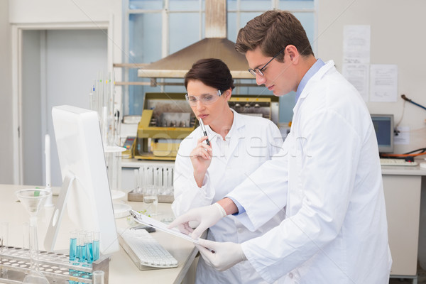 Scientists working attentively with computer Stock photo © wavebreak_media