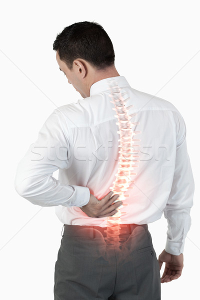 Colonna vertebrale uomo mal di schiena composito digitale mano medicina Foto d'archivio © wavebreak_media